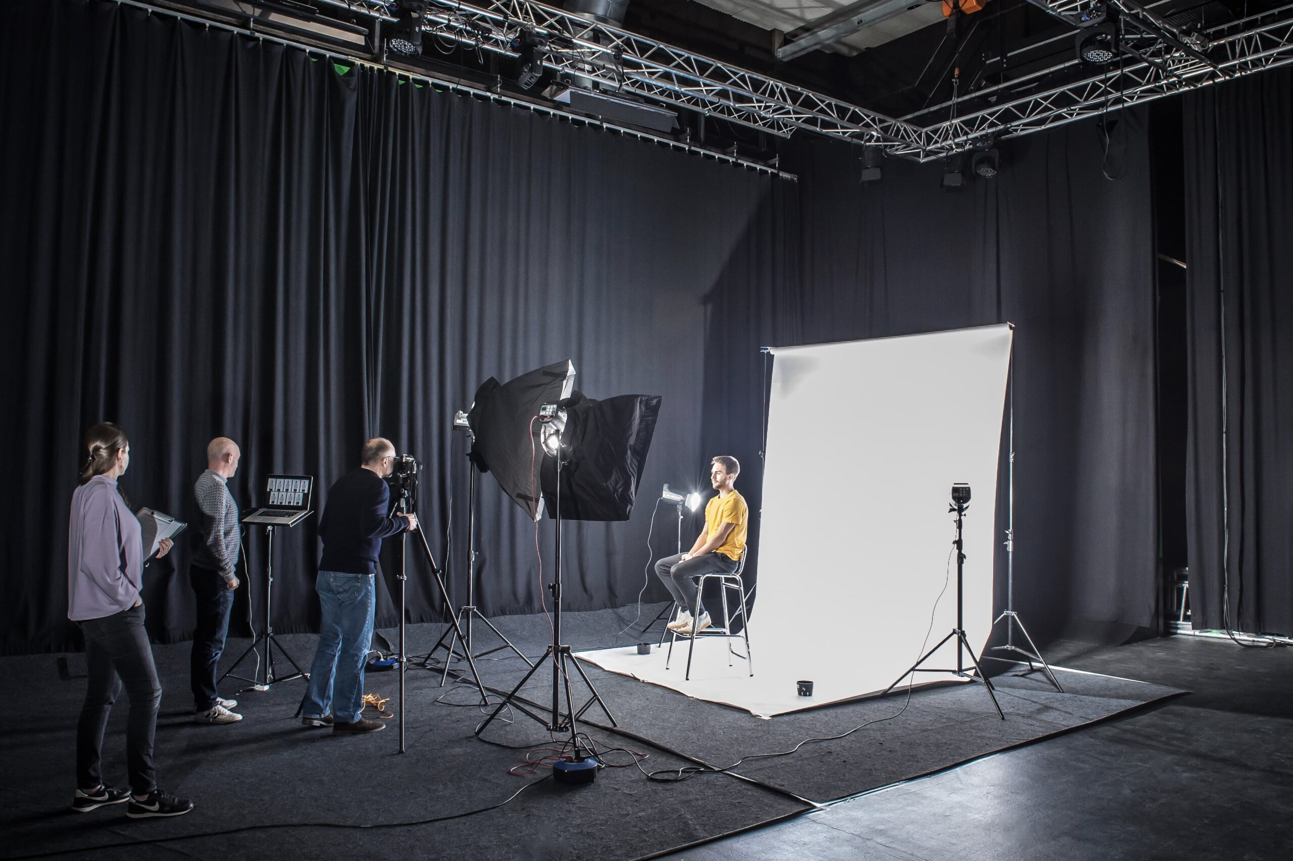 Picture of the Beehived Media team working in the video studio